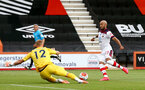 BOURNEMOUTH, ENGLAND - JULY 19: Aaron Ramsdale (L) of bournemouth and Nathan Redmond (R) of southampton during the Premier League match between AFC Bournemouth and Southampton FC at Vitality Stadium on July 19, 2020 in Bournemouth, United Kingdom. Football Stadiums around Europe remain empty due to the Coronavirus Pandemic as Government social distancing laws prohibit fans inside venues resulting in all fixtures being played behind closed doors. (Photo by Matt Watson/Southampton FC via Getty Images)