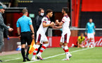BOURNEMOUTH, ENGLAND - JULY 19: Ché Adams (L) comes on for Shane Long (R) of southampton during the Premier League match between AFC Bournemouth and Southampton FC at Vitality Stadium on July 19, 2020 in Bournemouth, United Kingdom. Football Stadiums around Europe remain empty due to the Coronavirus Pandemic as Government social distancing laws prohibit fans inside venues resulting in all fixtures being played behind closed doors. (Photo by Matt Watson/Southampton FC via Getty Images)