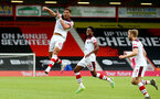 BOURNEMOUTH, ENGLAND - JULY 19: Ché Adams goal celebration during the Premier League match between AFC Bournemouth and Southampton FC at Vitality Stadium on July 19, 2020 in Bournemouth, United Kingdom. Football Stadiums around Europe remain empty due to the Coronavirus Pandemic as Government social distancing laws prohibit fans inside venues resulting in all fixtures being played behind closed doors. (Photo by Matt Watson/Southampton FC via Getty Images)