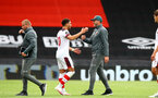 BOURNEMOUTH, ENGLAND - JULY 19: Ché Adams (L) and Ralph Hasenhuttl (R) during the Premier League match between AFC Bournemouth and Southampton FC at Vitality Stadium on July 19, 2020 in Bournemouth, United Kingdom. Football Stadiums around Europe remain empty due to the Coronavirus Pandemic as Government social distancing laws prohibit fans inside venues resulting in all fixtures being played behind closed doors. (Photo by Matt Watson/Southampton FC via Getty Images)