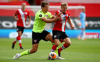 SOUTHAMPTON, ENGLAND - JULY 26: Sander Berge (L) of Sheffield and James Ward-Prowse (R) of Southampton during the Premier League match between Southampton FC and Sheffield United at St Mary's Stadium on April 17, 2020 in Southampton, United Kingdom. (Photo by Matt Watson/Southampton FC via Getty Images)