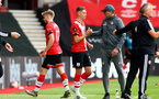 SOUTHAMPTON, ENGLAND - JULY 26: Stuart Armstrong (L) of Southampton replaced by Will Smallbone of Southampton during the Premier League match between Southampton FC and Sheffield United at St Mary's Stadium on April 17, 2020 in Southampton, United Kingdom. (Photo by Matt Watson/Southampton FC via Getty Images)