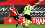 SOUTHAMPTON, ENGLAND - JULY 26: James Ward-Prowse (L) of Southampton and John Egan (R) of Sheffield during the Premier League match between Southampton FC and Sheffield United at St Mary's Stadium on April 17, 2020 in Southampton, United Kingdom. (Photo by Matt Watson/Southampton FC via Getty Images)