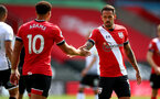 SOUTHAMPTON, ENGLAND - AUGUST 29: Ché Adams(L) and Danny Ings during a pre-season friendly between Southampton FC and Swansea City at St Marys Stadium, on August 29, 2020 in Southampton, England. (Photo by Matt Watson/Southampton FC via Getty Images)