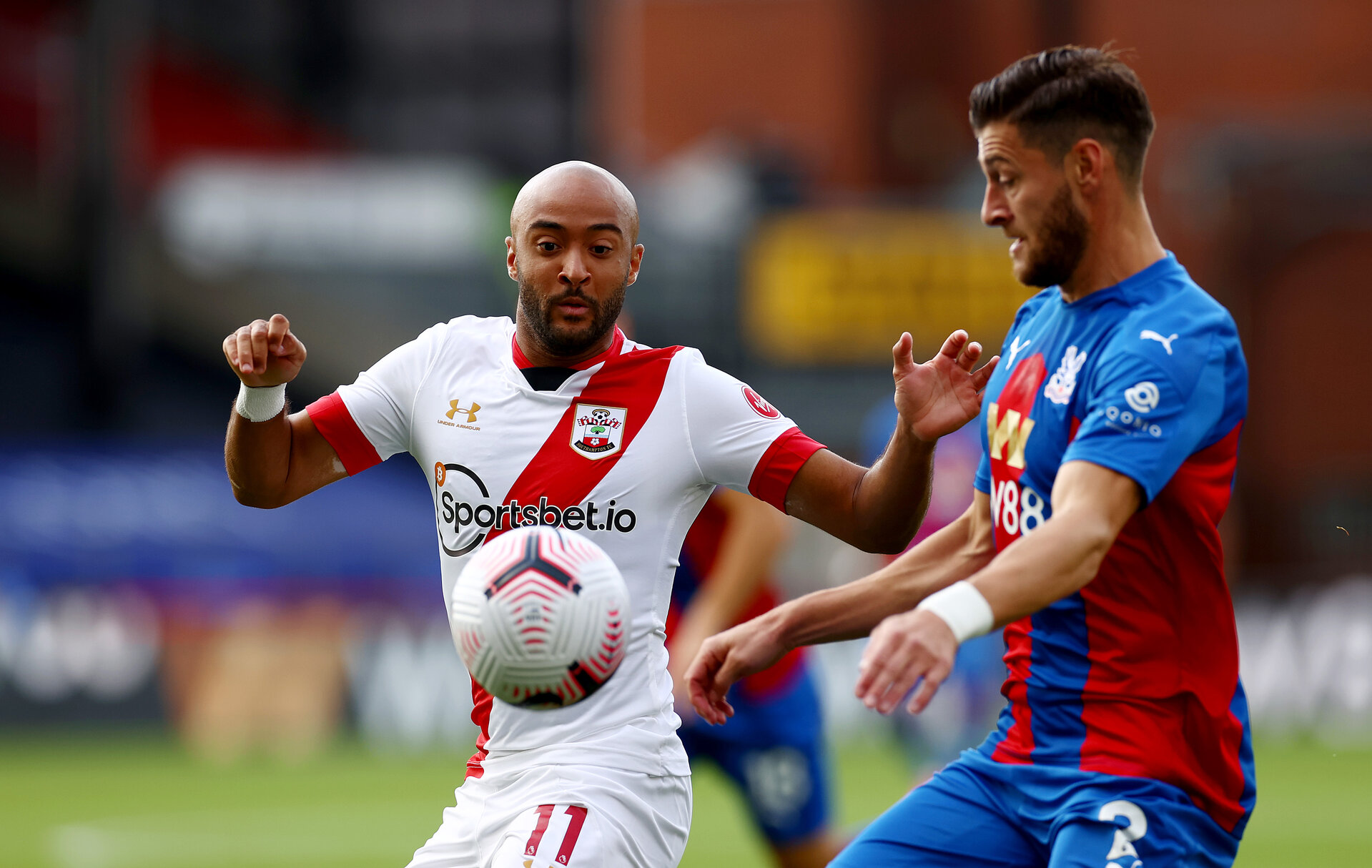 LONDON, ENGLAND - SEPTEMBER 12: Nathan Redmond(L) of Southampton and Joel Ward(R) of Crystal Palace during the Premier League match between Crystal Palace and Southampton at Selhurst Park on September 12, 2020 in London, United Kingdom. (Photo by Matt Watson/Southampton FC via Getty Images)