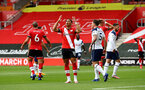 SOUTHAMPTON, ENGLAND - SEPTEMBER 20: Ché Adams of Southampton reacts after his shot is saved during the Premier League match between Southampton and Tottenham Hotspur at St Mary's Stadium on September 20, 2020 in Southampton, United Kingdom. (Photo by Matt Watson/Southampton FC via Getty Images)
