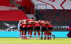 SOUTHAMPTON, ENGLAND - SEPTEMBER 20: Saints players huddle during the Premier League match between Southampton and Tottenham Hotspur at St Mary's Stadium on September 20, 2020 in Southampton, United Kingdom. (Photo by Matt Watson/Southampton FC via Getty Images)