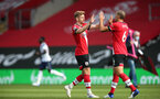 SOUTHAMPTON, ENGLAND - SEPTEMBER 20: Stuart Armstrong and Oriol Romeu during the Premier League match between Southampton and Tottenham Hotspur at St Mary's Stadium on September 20, 2020 in Southampton, United Kingdom. (Photo by Chris Moorhouse/Southampton FC via Getty Images)