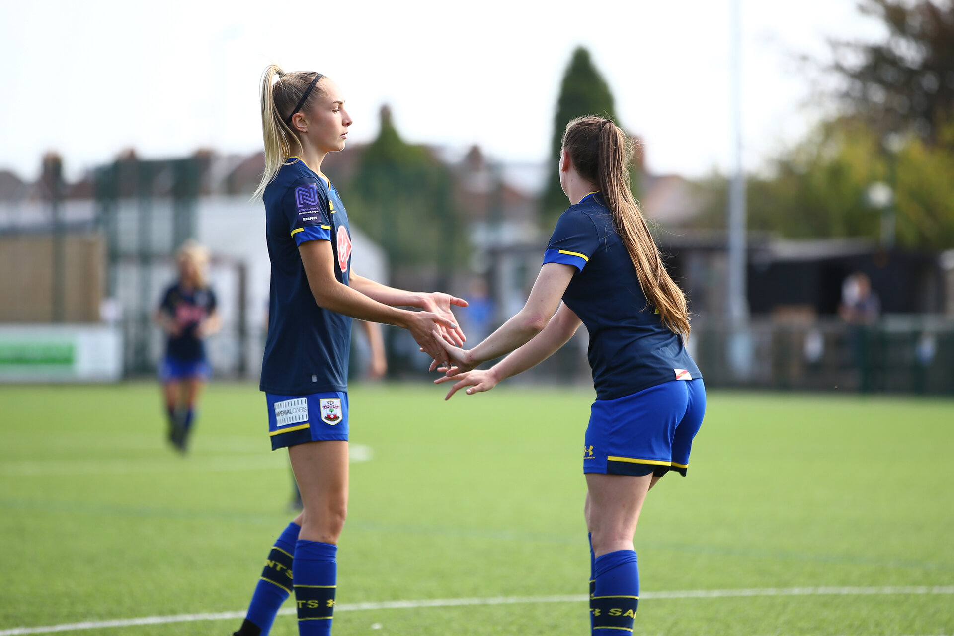 SOUTHAMPTON, ENGLAND - SEPTEMBER 20: Phoebe Williams (L) and Georgie Freeland (R) celebrates Georgie Freeland goal during the FAWNL match between Southampton Women and Poole Town FC at Specsavers County Ground on September 20, 2020 in Poole, England. (Photo by Isabelle Field/Southampton FC via Getty Images)