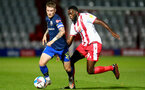 STEVENAGE, ENGLAND - SEPTEMBER 22: Callum Slattery (L) of Southampton and Inih Effiong (R) of Stevenage during the EFL Trophy match between Stevenage FC and Southampton FC B Team  at the Lamex Stadium on September 22, 2020 in Stevenage, England. (Photo by Isabelle Field/Southampton FC via Getty Images)