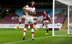 BURNLEY, ENGLAND - SEPTEMBER 26: Danny Ings (L) of Southampton celebrates with Ché Adams (R) after scoring the opener during the Premier League match between Burnley and Southampton at Turf Moor on September 26, 2020 in Burnley, United Kingdom. Sporting stadiums around the UK remain under strict restrictions due to the Coronavirus Pandemic as Government social distancing laws prohibit fans inside venues resulting in games being played behind closed doors. (Photo by Matt Watson/Southampton FC via Getty Images)