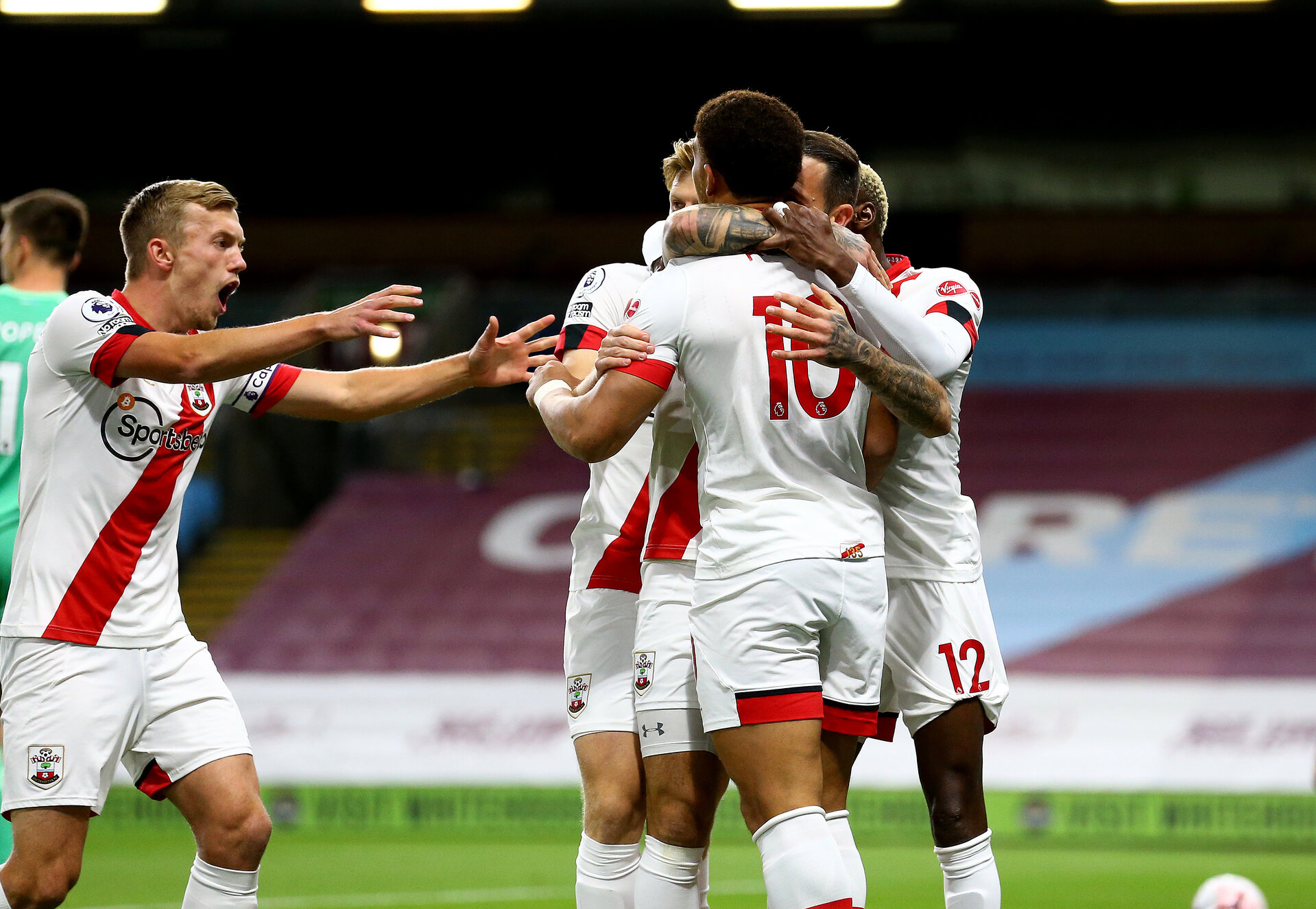 BURNLEY, ENGLAND - SEPTEMBER 26: Southampton players celebrating after Danny Ings scores the opening goal during the Premier League match between Burnley and Southampton at Turf Moor on September 26, 2020 in Burnley, United Kingdom. Sporting stadiums around the UK remain under strict restrictions due to the Coronavirus Pandemic as Government social distancing laws prohibit fans inside venues resulting in games being played behind closed doors. (Photo by Matt Watson/Southampton FC via Getty Images)