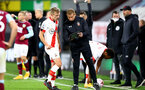 BURNLEY, ENGLAND - SEPTEMBER 26: James Ward-Prowse (L) of Southampton and Dave Watson (R) during the Premier League match between Burnley and Southampton at Turf Moor on September 26, 2020 in Burnley, United Kingdom. Sporting stadiums around the UK remain under strict restrictions due to the Coronavirus Pandemic as Government social distancing laws prohibit fans inside venues resulting in games being played behind closed doors. (Photo by Matt Watson/Southampton FC via Getty Images)