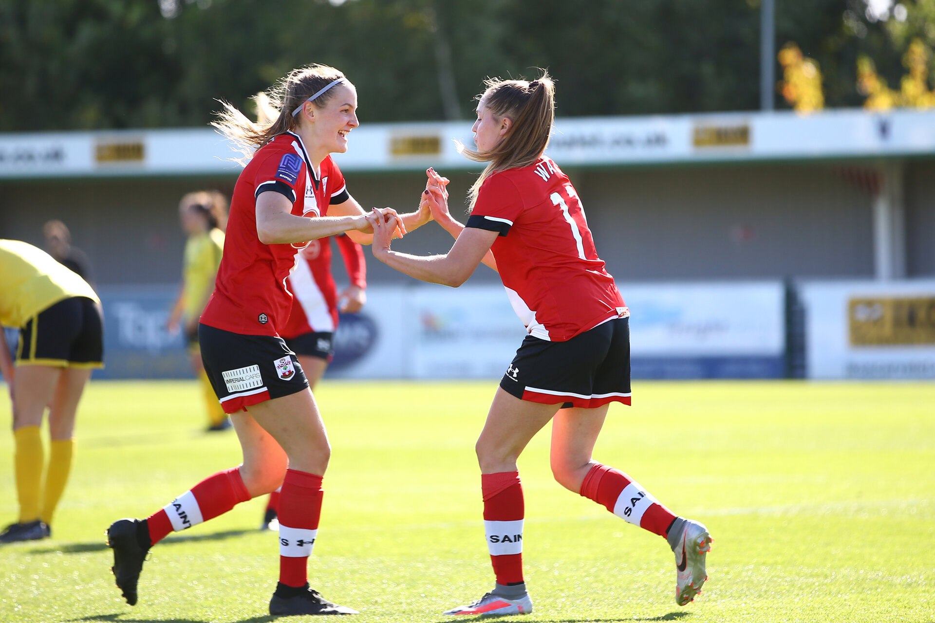Southampton, ENGLAND - SEPTEMBER 27: Ella Pusey (L) congratulates Alisha Ware (R) on her goal of Southampton during the FAWNL match between Southampton Women and Buckland Athletic at Snows Stadium on September 27, 2020 in Southampton, United Kingdom (Photo by Isabelle Field/Southampton FC via Getty Images)