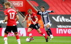 SOUTHAMPTON, ENGLAND - OCTOBER 04: James Ward-Prowse (L) of Southampton and Callum Robinson (R) of West Bromwich Albion during the Premier League match between Southampton and West Bromwich Albion at St Mary's Stadium on October 4, 2020 in Southampton, United Kingdom. Sporting stadiums around the UK remain under strict restrictions due to the Coronavirus Pandemic as Government social distancing laws prohibit fans inside venues resulting in games being played behind closed doors. (Photo by Matt Watson/Southampton FC via Getty Images)