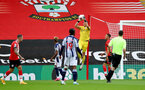 SOUTHAMPTON, ENGLAND - OCTOBER 04: Alex McCarthy (center) of Southampton in the air making a save during the Premier League match between Southampton and West Bromwich Albion at St Mary's Stadium on October 4, 2020 in Southampton, United Kingdom. Sporting stadiums around the UK remain under strict restrictions due to the Coronavirus Pandemic as Government social distancing laws prohibit fans inside venues resulting in games being played behind closed doors. (Photo by Matt Watson/Southampton FC via Getty Images)