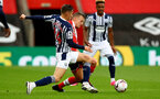 SOUTHAMPTON, ENGLAND - OCTOBER 04: Conor Townsend (L)  of West Bromwich Albion batteling for the ball agaisnt James Ward-Prowse (R) of Southampton during the Premier League match between Southampton and West Bromwich Albion at St Mary's Stadium on October 4, 2020 in Southampton, United Kingdom. Sporting stadiums around the UK remain under strict restrictions due to the Coronavirus Pandemic as Government social distancing laws prohibit fans inside venues resulting in games being played behind closed doors. (Photo by Matt Watson/Southampton FC via Getty Images)