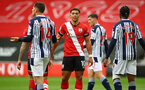 SOUTHAMPTON, ENGLAND - OCTOBER 04: Ché Adams (center) of Southampton during the Premier League match between Southampton and West Bromwich Albion at St Mary's Stadium on October 4, 2020 in Southampton, United Kingdom. Sporting stadiums around the UK remain under strict restrictions due to the Coronavirus Pandemic as Government social distancing laws prohibit fans inside venues resulting in games being played behind closed doors. (Photo by Matt Watson/Southampton FC via Getty Images)