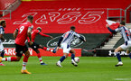 SOUTHAMPTON, ENGLAND - OCTOBER 04: Moussa Djenepo (L) of Southampton strike to open the scoring during the Premier League match between Southampton and West Bromwich Albion at St Mary's Stadium on October 4, 2020 in Southampton, United Kingdom. Sporting stadiums around the UK remain under strict restrictions due to the Coronavirus Pandemic as Government social distancing laws prohibit fans inside venues resulting in games being played behind closed doors. (Photo by Matt Watson/Southampton FC via Getty Images)
