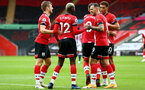 SOUTHAMPTON, ENGLAND - OCTOBER 04: Stuart Armstrong (L) and Danny Ings (R) congratulates Moussa Djenepo (center) on his goal during the Premier League match between Southampton and West Bromwich Albion at St Mary's Stadium on October 4, 2020 in Southampton, United Kingdom. Sporting stadiums around the UK remain under strict restrictions due to the Coronavirus Pandemic as Government social distancing laws prohibit fans inside venues resulting in games being played behind closed doors. (Photo by Matt Watson/Southampton FC via Getty Images)