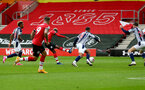 SOUTHAMPTON, ENGLAND - OCTOBER 04: Moussa Djenepo of Southampton scores his teams opening goal during the Premier League match between Southampton and West Bromwich Albion at St Mary's Stadium on October 04, 2020 in Southampton, United Kingdom. Sporting stadiums around the UK remain under strict restrictions due to the Coronavirus Pandemic as Government social distancing laws prohibit fans inside venues resulting in games being played behind closed doors. (Photo by Matt Watson/Southampton FC via Getty Images)