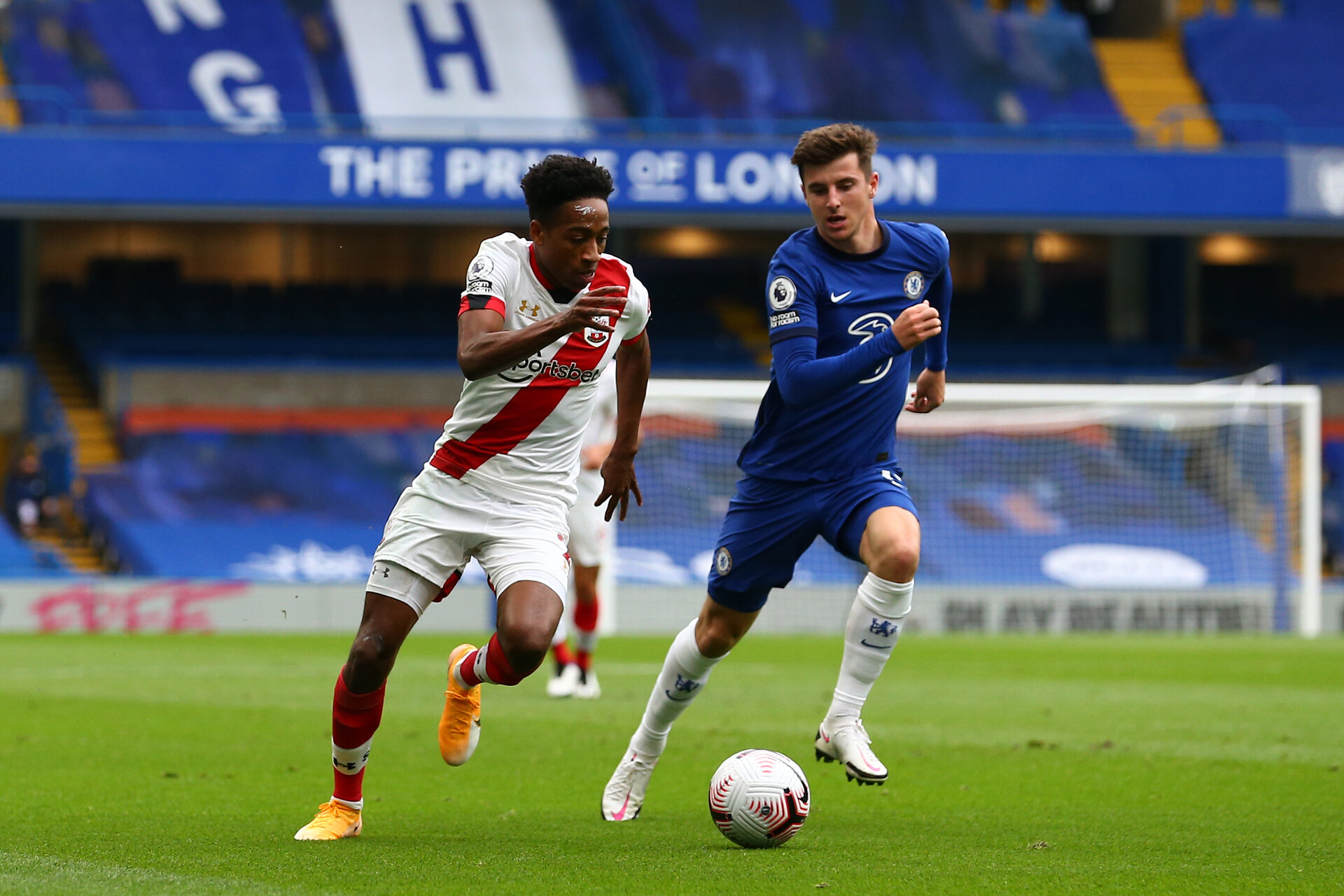 LONDON, ENGLAND - OCTOBER 17:  Kyle Walker-Peters (L) of Southampton and Mason Mount (R) of Chelsea during the Premier League match between Chelsea and Southampton at Stamford Bridge on October 17, 2020 in London, United Kingdom. Sporting stadiums around the UK remain under strict restrictions due to the Coronavirus Pandemic as Government social distancing laws prohibit fans inside venues resulting in games being played behind closed doors. (Photo by Matt Watson/Southampton FC via Getty Images)
