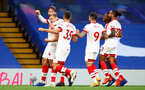 LONDON, ENGLAND - OCTOBER 17: Southampton players celebrate Jannik Vestergaard goal  during the Premier League match between Chelsea and Southampton at Stamford Bridge on October 17, 2020 in London, United Kingdom. Sporting stadiums around the UK remain under strict restrictions due to the Coronavirus Pandemic as Government social distancing laws prohibit fans inside venues resulting in games being played behind closed doors. (Photo by Matt Watson/Southampton FC via Getty Images)