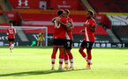 SOUTHAMPTON, ENGLAND - OCTOBER 25: Che Adams(L) of celebrates with Danny Ings(centre) and Ryan Bertrand(R) during the Premier League match between Southampton and Everton at St Mary's Stadium on October 25, 2020 in Southampton, England. Sporting stadiums around the UK remain under strict restrictions due to the Coronavirus Pandemic as Government social distancing laws prohibit fans inside venues resulting in games being played behind closed doors. (Photo by Matt Watson/Southampton FC via Getty Images)