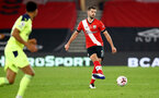 SOUTHAMPTON, ENGLAND - NOVEMBER 06: Jack Stephens of Southampton during the Premier League match between Southampton and Newcastle United at St Mary's Stadium on November 06, 2020 in Southampton, England. Sporting stadiums around the UK remain under strict restrictions due to the Coronavirus Pandemic as Government social distancing laws prohibit fans inside venues resulting in games being played behind closed doors. (Photo by Matt Watson/Southampton FC via Getty Images)