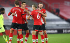 SOUTHAMPTON, ENGLAND - NOVEMBER 06: Jannik Vestergaard(L), Jan Bednarek, Oriol Romeu and Jack Stephens(R) congratulating each other at full time during the Premier League match between Southampton and Newcastle United at St Mary's Stadium on November 06, 2020 in Southampton, England. Sporting stadiums around the UK remain under strict restrictions due to the Coronavirus Pandemic as Government social distancing laws prohibit fans inside venues resulting in games being played behind closed doors. (Photo by Matt Watson/Southampton FC via Getty Images)