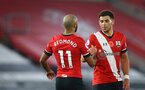 SOUTHAMPTON, ENGLAND - NOVEMBER 06: Nathan Redmond(L) and Che Adams of Southampton during the Premier League match between Southampton and Newcastle United at St Mary's Stadium on November 06, 2020 in Southampton, England. Sporting stadiums around the UK remain under strict restrictions due to the Coronavirus Pandemic as Government social distancing laws prohibit fans inside venues resulting in games being played behind closed doors. (Photo by Matt Watson/Southampton FC via Getty Images)
