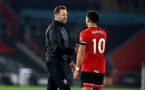 SOUTHAMPTON, ENGLAND - NOVEMBER 06: Ralph Hasenhüttl(L) and Che Adams of during the Premier League match between Southampton and Newcastle United at St Mary's Stadium on November 06, 2020 in Southampton, England. Sporting stadiums around the UK remain under strict restrictions due to the Coronavirus Pandemic as Government social distancing laws prohibit fans inside venues resulting in games being played behind closed doors. (Photo by Matt Watson/Southampton FC via Getty Images)