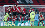 SOUTHAMPTON, ENGLAND - NOVEMBER 06: Southampton defend against a free-kick during the Premier League match between Southampton and Newcastle United at St Mary's Stadium on November 6, 2020 in Southampton, United Kingdom. Sporting stadiums around the UK remain under strict restrictions due to the Coronavirus Pandemic as Government social distancing laws prohibit fans inside venues resulting in games being played behind closed doors. (Photo by Chris Moorhouse/Southampton FC via Getty Images)
