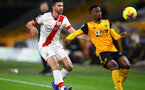 WOLVERHAMPTON, ENGLAND - NOVEMBER 23: Shane Long(L) of Southampton and Nelson Semedo(R) of Wolves during the Premier League match between Wolverhampton Wanderers and Southampton at Molineux on November 23, 2020 in Wolverhampton, England. Sporting stadiums around the UK remain under strict restrictions due to the Coronavirus Pandemic as Government social distancing laws prohibit fans inside venues resulting in games being played behind closed doors. (Photo by Matt Watson/Southampton FC via Getty Images)