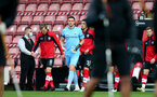 SOUTHAMPTON, ENGLAND - NOVEMBER 29: Southampton players walking out ahead of the Premier League match between Southampton and Manchester United at St Mary's Stadium on November 29, 2020 in Southampton, England. Sporting stadiums around the UK remain under strict restrictions due to the Coronavirus Pandemic as Government social distancing laws prohibit fans inside venues resulting in games being played behind closed doors. (Photo by Matt Watson/Southampton FC via Getty Images)