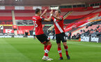 SOUTHAMPTON, ENGLAND - NOVEMBER 29: Jan Bednarek(L) of Southampton celebrates scoring with James Ward-Prowse(R) of Southampton during the Premier League match between Southampton and Manchester United at St Mary's Stadium on November 29, 2020 in Southampton, England. Sporting stadiums around the UK remain under strict restrictions due to the Coronavirus Pandemic as Government social distancing laws prohibit fans inside venues resulting in games being played behind closed doors. (Photo by Matt Watson/Southampton FC via Getty Images)