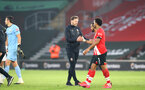 SOUTHAMPTON, ENGLAND - NOVEMBER 29: Ralph Hasenhuttl Southampton manager (L) and Ryan Bertrand (R) of Southampton at full time during the Premier League match between Southampton and Manchester United at St Mary's Stadium on November 29, 2020 in Southampton, England. Sporting stadiums around the UK remain under strict restrictions due to the Coronavirus Pandemic as Government social distancing laws prohibit fans inside venues resulting in games being played behind closed doors. (Photo by Matt Watson/Southampton FC via Getty Images)