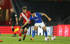 SOUTHAMPTON, ENGLAND - NOVEMBER 30: Jake Vokins (L) of Southampton and  Steven Alzate (R) of Brighton & Hove Albion during the Premier League 2 match between Southampton FC B Team and Brighton & Hove Albion at the St Mary's Stadium on November 30, 2020 in Southampton, England. (Photo by Isabelle Field/Southampton FC via Getty Images)