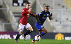 MANCHESTER, ENGLAND - DECEMBER 04: Tyreke Johnson(L) of Southampton during the Premier League 2 match between Manchester United and Southampton B Team at Leigh Sports Village on December 04, 2020 in Manchester, England. (Photo by Isabelle Field/Southampton FC via Getty Images)