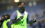 BRIGHTON, ENGLAND - DECEMBER 07: Mohammed Salisu of Southampton warms up  during the Premier League match between Brighton & Hove Albion and Southampton at American Express Community Stadium on December 07, 2020 in Brighton, England. A limited number of fans (2000) are welcomed back to stadiums to watch elite football across England. This was following easing of restrictions on spectators in tiers one and two areas only. (Photo by Matt Watson/Southampton FC via Getty Images)