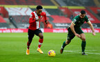SOUTHAMPTON, ENGLAND - DECEMBER 13: Kyle Walker-Peters(L) of Southampton beats Enda Stevens(R) of Sheffield united during the Premier League match between Southampton and Sheffield United at St Mary's Stadium on December 13, 2020 in Southampton, England. A limited number of spectators (2000) are welcomed back to stadiums to watch elite football across England. This was following easing of restrictions on spectators in tiers one and two areas only. (Photo by Matt Watson/Southampton FC via Getty Images)