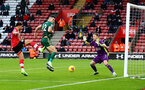 SOUTHAMPTON, ENGLAND - DECEMBER 13: Che Adams(L) of Southampton opens the scoring during the Premier League match between Southampton and Sheffield United at St Mary's Stadium on December 13, 2020 in Southampton, England. A limited number of spectators (2000) are welcomed back to stadiums to watch elite football across England. This was following easing of restrictions on spectators in tiers one and two areas only. (Photo by Matt Watson/Southampton FC via Getty Images)