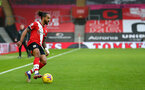SOUTHAMPTON, ENGLAND - DECEMBER 13: Theo Walcott of Southampton during the Premier League match between Southampton and Sheffield United at St Mary's Stadium on December 13, 2020 in Southampton, England. A limited number of spectators (2000) are welcomed back to stadiums to watch elite football across England. This was following easing of restrictions on spectators in tiers one and two areas only. (Photo by Matt Watson/Southampton FC via Getty Images)