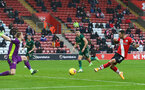 SOUTHAMPTON, ENGLAND - DECEMBER 13: Danny Ings(R) of Southampton shoots at goal but is denied by Aaron Ramsdale of Sheffield United during the Premier League match between Southampton and Sheffield United at St Mary's Stadium on December 13, 2020 in Southampton, England. A limited number of spectators (2000) are welcomed back to stadiums to watch elite football across England. This was following easing of restrictions on spectators in tiers one and two areas only. (Photo by Matt Watson/Southampton FC via Getty Images)