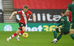 SOUTHAMPTON, ENGLAND - DECEMBER 13: Stuart Armstrong of Southampton during the Premier League match between Southampton and Sheffield United at St Mary's Stadium on December 13, 2020 in Southampton, England. A limited number of spectators (2000) are welcomed back to stadiums to watch elite football across England. This was following easing of restrictions on spectators in tiers one and two areas only. (Photo by Matt Watson/Southampton FC via Getty Images)