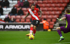 SOUTHAMPTON, ENGLAND - DECEMBER 13: Danny Ings(L) of Southampton shoots at goal but is denied by Aaron Ramsdale of Sheffield united during the Premier League match between Southampton and Sheffield United at St Mary's Stadium on December 13, 2020 in Southampton, England. A limited number of spectators (2000) are welcomed back to stadiums to watch elite football across England. This was following easing of restrictions on spectators in tiers one and two areas only. (Photo by Matt Watson/Southampton FC via Getty Images)