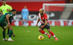 SOUTHAMPTON, ENGLAND - DECEMBER 13: Nathan Redmond of during the Premier League match between Southampton and Sheffield United at St Mary's Stadium on December 13, 2020 in Southampton, England. A limited number of spectators (2000) are welcomed back to stadiums to watch elite football across England. This was following easing of restrictions on spectators in tiers one and two areas only. (Photo by Matt Watson/Southampton FC via Getty Images)