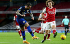 LONDON, ENGLAND - DECEMBER 16: Danny Ings (L) and David Luiz (R) of Arsenal during the Premier League match between Arsenal and Southampton at Emirates Stadium on December 16, 2020 in London, England. The match will be played without fans, behind closed doors as a Covid-19 precaution. (Photo by Matt Watson/Southampton FC via Getty Images)