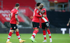 SOUTHAMPTON, ENGLAND - DECEMBER 19: Moussa Djenepo(R) of Southampton ahead of kick off at the Premier League match between Southampton and Manchester City at St Mary's Stadium on December 19, 2020 in Southampton, England. A limited number of fans (2000) are welcomed back to stadiums to watch elite football across England. This was following easing of restrictions on spectators in tiers one and two areas only. (Photo by Matt Watson/Southampton FC via Getty Images)