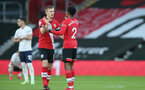 SOUTHAMPTON, ENGLAND - DECEMBER 19: James Ward-Prowse (L) of Southampton and Kyle Walker-Peters (R) of ahead of kick off at the Premier League match between Southampton and Manchester City at St Mary's Stadium on December 19, 2020 in Southampton, England. A limited number of fans (2000) are welcomed back to stadiums to watch elite football across England. This was following easing of restrictions on spectators in tiers one and two areas only. (Photo by Matt Watson/Southampton FC via Getty Images)